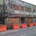 The Healing Center's historic facade exposed, after partial removal of metal screen
