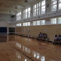 The basketball court interior, post-completion, now with a raised perimeter track