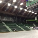 Rehabilitated fieldhouse arena, with historic ceiling trusses and redwood decking exposed