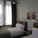 The hotel rehabilitation resulted in clean, contemporary room interiors